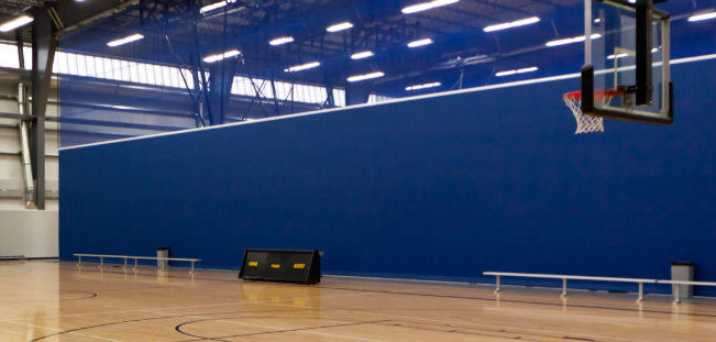 blue divider curtains in gym