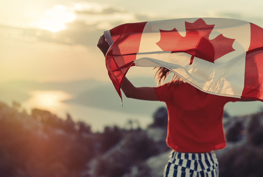 person holding canada flag with view